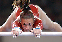 Arkansas gymnast Tiffany Berry performs her uneven bars routine during the inaugural season of the Lady Razorback gymnastics team.