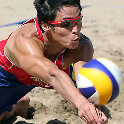 DURBAN, SOUTH AFRICA - DECEMBER 11:  Jian Li of CHN looking to keep the ball alive during the FIVB Durban Open at New Beach on December 11, 2013 in Durban, South Africa.  (Photo by Steve Haag/Getty Images for FIVB)