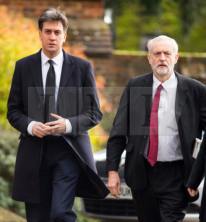 **FILE PICTURE - Monday December 21 marks 100 days since Jeremy Corbyn became leader of the Labour Party**© Licensed to London News Pictures. 13/11/2015. London, UK. Former Labour party leader ED MILIBAND and current Labour party leader JEREMY CORBYN arrive for The funeral of former Labour MP Michael Meacher at St Mary's Church in Wimbledon, south west London.  Michael Meacher, who was a Labour MP in Oldham for over 40 years, served as Minister of State for the Environment in the Tony Blair government.  Photo credit: Ben Cawthra/LNP