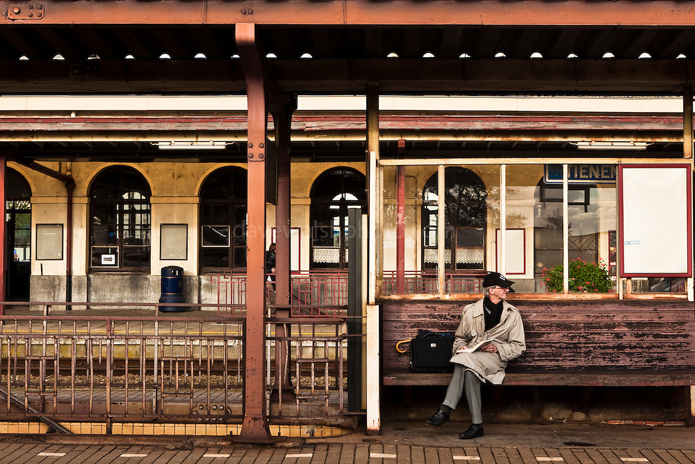 Waiting for the train, in Tienen, Flanders, Belgium. Many Belgian railway stations seem run down, but the trains run mostly on time. The Belgian rail company, SNCB announced in August 2012 that it was almost 4 billion euros in debt.