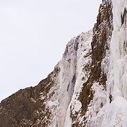 "Róbert Halldórsson climbing the first pitch on the climb ""Bjarta hlíðin"" WI6 at Eyjafjöllum, southcoast Iceland."