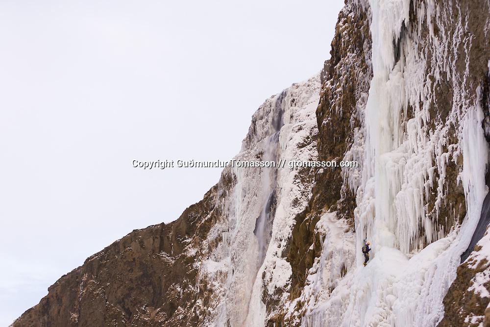"Róbert Halldórsson climbing the first pitch on the climb ""Bjarta hlíðin"" WI6 at Eyjafjöllum, southcoast Iceland."