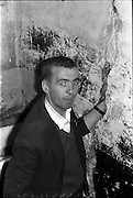 16/06/1963.06/16/1963.16 June 1963.Evacuation of Hendrick St. houses. Andy Lucy puts his arm into a wall crak in his home at No.8 Hendrick Street, Dublin.
