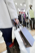 female person with various shopping bags