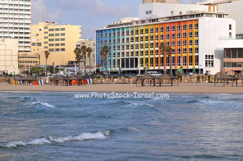Israel, Tel Aviv, cityscape and coastline as seen from west. The facade of the Dan Hotel designed by Yaacov Agam. The Mediterranean sea in the foreground