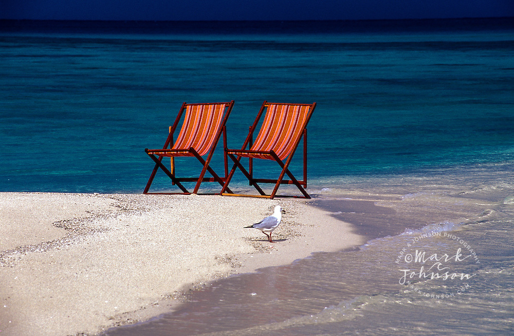 Australia, Qld., Great Barrier Reef, 2 beach chairs on beach.