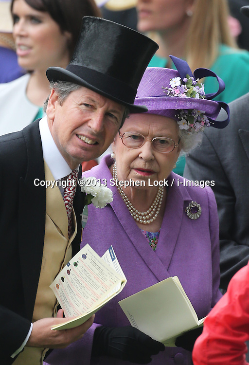The Queen and her racing manager John Warren at Ladies Day at Royal Ascot 2013, Thursday, 20th June 2013<br /> Picture by Stephen Lock / i-Images