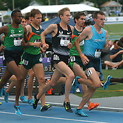 LAGAT - 13USA, Des Moines, Ia.  - With three laps to go the pace quickened in the 5,000 as runners began to maneuver for position behind winner Bernard Lagat.  Photo by David Peterson