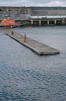 Empty mooring at DunLaoghaire Pier Dublin Ireland in the winter, lifeboat in the background