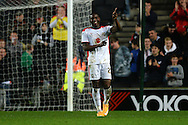 Benik Afobe of MK Dons celebrates scoring his sides fourth goal to make the scoreline 4-0 and his hat-trick during the Sky Bet League 1 match between Milton Keynes Dons and Colchester United at stadium:mk, Milton Keynes<br /> Picture by Richard Blaxall/Focus Images Ltd +44 7853 364624<br /> 29/11/2014