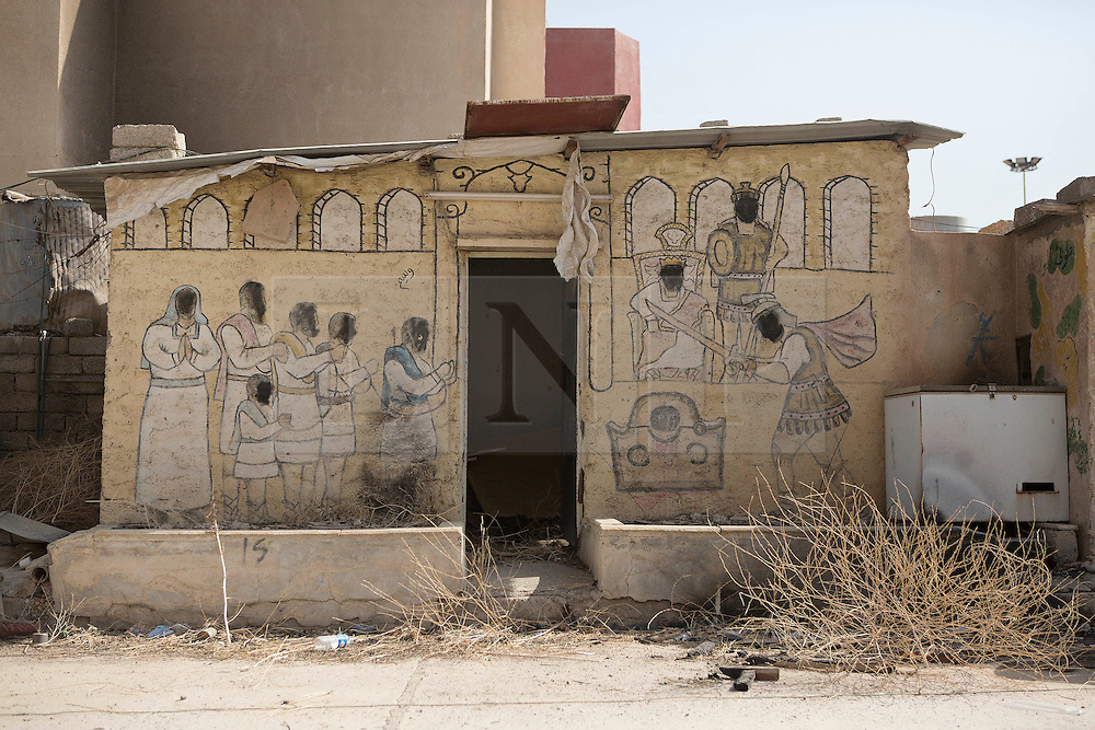 Licensed to London News Pictures. 23/10/2016. A mural defaced by Islamic State militants is seen outside the Mart Shmony Church in Bartella, Iraq.<br /> <br /> Bartella, a mainly Christian town with a population of around 30,000 people before being taken by the Islamic State in August 2014, was captured two days ago by the Iraqi Army's Counter Terrorism force as part of the ongoing offensive to retake Mosul. Although ISIS militants were pushed back a large amount of improvised explosive devices are still being found in the town's buildings. Photo credit: Matt Cetti-Roberts/LNP