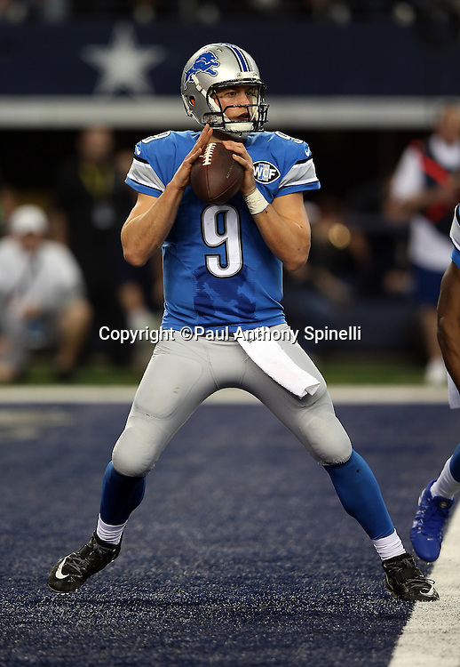 Detroit Lions quarterback Matthew Stafford (9) drops back to pass from his own end zone during the NFL week 18 NFC Wild Card postseason football game against the Dallas Cowboys on Sunday, Jan. 4, 2015 in Arlington, Texas. The Cowboys won the game 24-20. ©Paul Anthony Spinelli