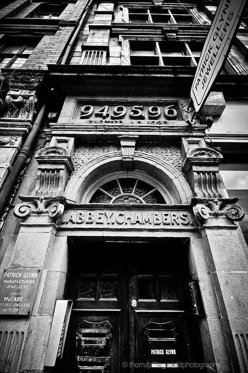 Dublin City, Ireland: An Old and ornate doorway on Dublin's Abbey Street. Moody black and White Image.<br /> For Editorial Use Only