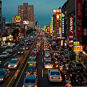 Evening traffic looking eastwards along Dung Men Road, Tainan City, Taiwan