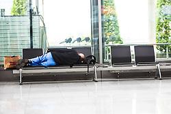 THEMENBILD, Airport Muenchen, Franz Josef Strauß (IATA: MUC, ICAO: EDDM), Der Flughafen Muenchen zählt zu den groessten Drehkreuzen Europas, rund 100 Fluggesellschaften verbinden ihn mit 230 Zielen in 70 Laendern, im Bild ein schlafender Passagier wartet auf seinen Abflug // THEME IMAGE, FEATURE - Airport Munich, Franz Josef Strauss (IATA: MUC, ICAO: EDDM), The airport Munich is one of the largest hubs in Europe, approximately 100 airlines connect it to 230 destinations in 70 countries. picture shows: a sleeping passenger waiting for his departure, Munich, Germany on 2012/05/06. EXPA Pictures © 2012, PhotoCredit: EXPA/ Juergen Feichter
