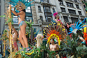 A float passes, filled with people in jungle-inspired costumes.
