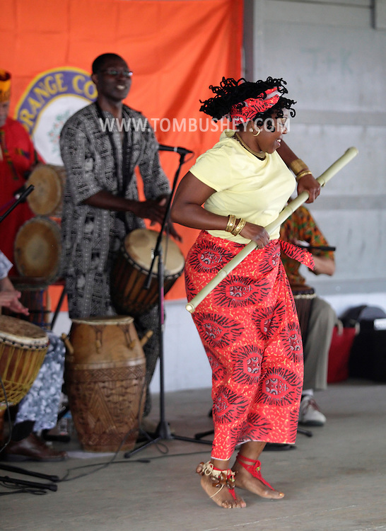 Hamptonburgh, New York - A member of the Sankofa Drum and Dance Ensemble dances at the fourth annual Earth & Water Festival at Thomas Bull Memorial Park on June 4, 2011.