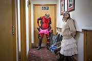 UNITED KINGDOM, London: 25 October 2015. <br /> Comic Con Feature.<br /> A young daughter waits for her father to get dressed in a pub not too far from the convention on the final day of the MCM London Comic Con.<br /> Photo: Rick Findler / Story Picture Agency