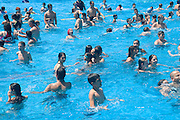 Israel, Sfaim water Park, summer fun in a crowded swimming pool
