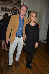 JAMES LINDSAY and OLIVIA FRANKLIN at a private view of photographs by renowned wildlife photographer David Yarrow in aid of TUSK entitled 'Wild Encounters' held at Somerset House on 19th September 2016.
