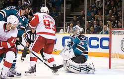 April 29, 2010; San Jose, CA, USA; San Jose Sharks goaltender Evgeni Nabokov (20) makes a save in front of Detroit Red Wings right wing Johan Franzen (93) during the third period in game one of the western conference semifinals of the 2010 Stanley Cup Playoffs at HP Pavilion. The Sharks defeated the Red Wings 4-3. Mandatory Credit: Jason O. Watson / US PRESSWIRE