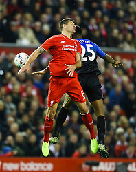 Dejan Lovren of Liverpool climbs for a header with Sylvain Distin of Bournemouth - Mandatory byline: Matt McNulty/JMP - 07966 386802 - 28/10/2015 - FOOTBALL - Anfield - Liverpool, Merseyside - Liverpool v AFC Bournemouth - Capital One Cup