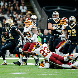Nov 19, 2017; New Orleans, LA, USA; New Orleans Saints running back Alvin Kamara (41) runs past Washington Redskins safety DeAngelo Hall (23) during the second half of a game at the Mercedes-Benz Superdome. The Saints defeated the Redskins 34-31 in overtime. Mandatory Credit: Derick E. Hingle-USA TODAY Sports