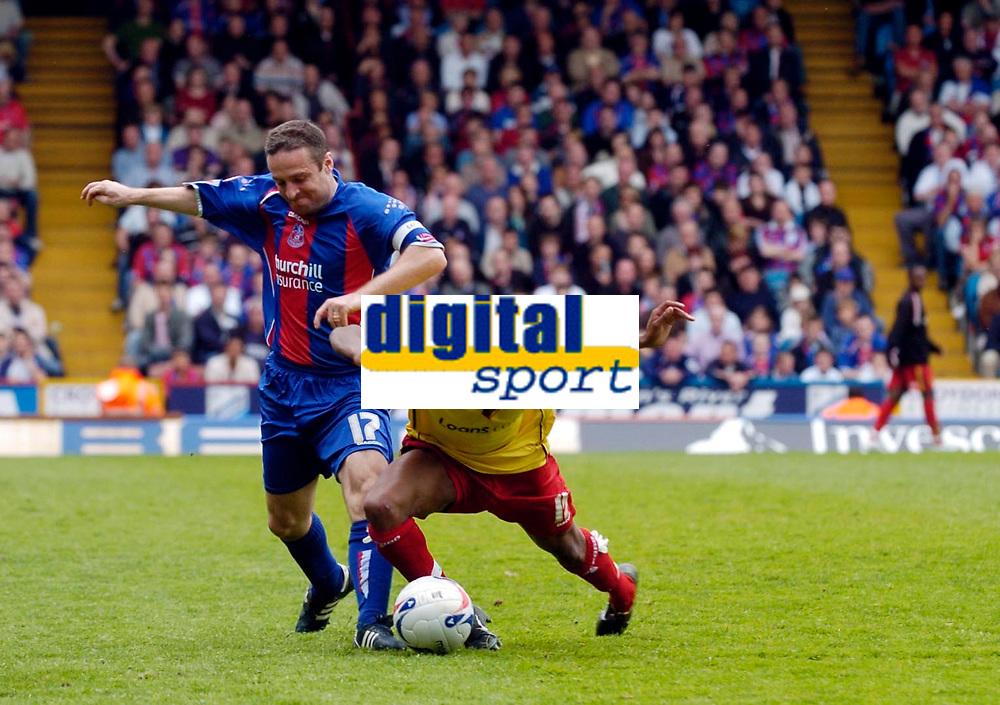 Photo: Daniel Hambury.<br />Crystal Palace v Watford. Coca Cola Championship. Play off Semi-Final, First Leg. 06/05/2006.<br />Palace's Michael Hughes fouls Watford's Ashley Young, the Watford man got up to score his side's second goal.