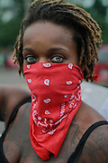 August 15, 2014- Ferguson, Mo.- Protesters donned bandanas while they marched in support of Michael Brown, an unarmed black man killed by a police officer. 8/15/2014 Photo by Dave Gershgorn/ NYCity Photo Wire