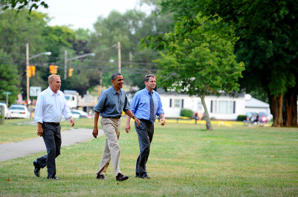 Former Ohio Governor Ted Strickland, President Barack Obama, and Senator Sherrod Brown make their way to a rally for President Obama in Parma, Ohio Thursday.