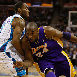 Mar 29, 2010; New Orleans, LA, USA; Los Angeles Lakers guard Kobe Bryant (24) drives past New Orleans Hornets guard Marcus Thornton (5) during the first half at the New Orleans Arena. Mandatory Credit: Derick E. Hingle-US PRESSWIRE