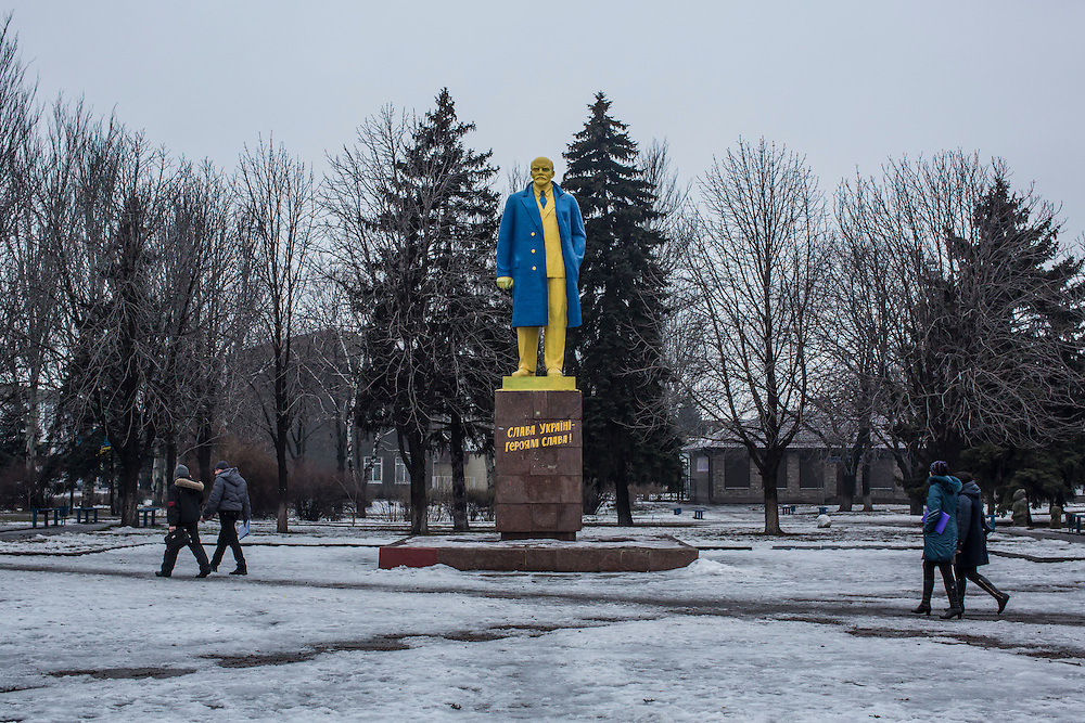 VELYKA NOVOSILKA, UKRAINE - JANUARY 22, 2015: A statue of Bolshevik leader Vladimir Lenin is painted in the colors of Ukraine stands in a central square in Velyka Novosilka, Ukraine. Lenin statues around Ukraine have been torn down and destroyed since the Maidan revolution in a symbolic break with the Russian revolutionary and the Soviet system that tied Ukraine to Russia for decades. CREDIT: Brendan Hoffman for The New York Times