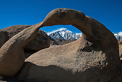 Snowcapped Mount Whitney viewed through Mobius Arch, Alabama Hills, California, United States of America