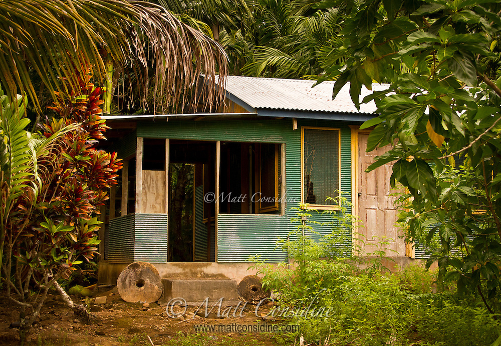 Local House with Family Stone Money Outside, Yap Micronesia (Photo by Matt Considine - Images of Asia Collection)