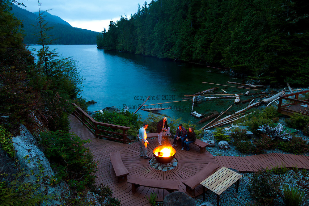 Eagle Nook Wilderness Resort and Spa is located on a remote area of Vancouver Island.   An outdoor fire pit is a great place to enjoy the long summer evenings with a beverage and conversation next to the water.