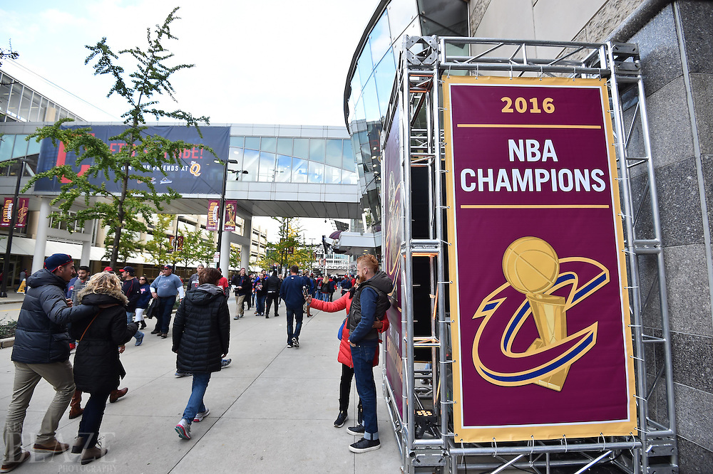 Oct 25, 2016; Cleveland, OH, USA; Fans walk past a Cleveland Cavaliers championship banner before game one of the 2016 World Series between the Chicago Cubs and the Cleveland Indians at Progressive Field. Mandatory Credit: Ken Blaze-USA TODAY Sports