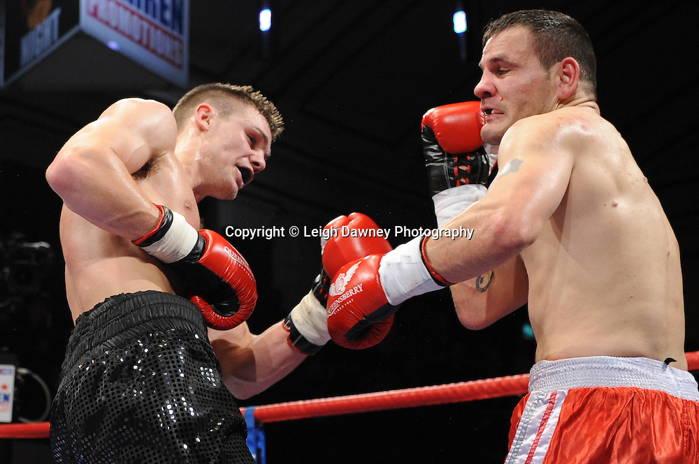 Welterweight Freddie Turner (black shorts) defeats Billy Smith at York Hall, Bethnal Green, London on the 19th February 2011. Frank Warren Promotions. Photo credit © Leigh Dawney.
