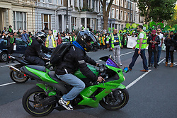 London, UK. 14 June, 2019. Motorcycle riders from UnitedRide4Grenfell pay tribute to members of the Grenfell community taking part in the Grenfell Silent Walk around North Kensington on the second anniversary of the Grenfell Tower fire on 14th June 2017 in which 72 people died and over 70 were injured.