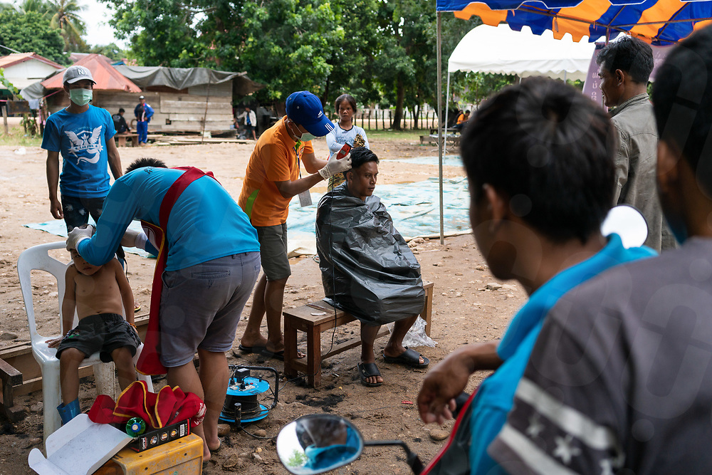 August 04, 2018 - Attapeu (Laos). An impromptu barber shop is seen inside one of the school used to shelter some of the 3000 people who have been displaced from the villages affected by the collapse of the dam. © Thomas Cristofoletti / Ruom