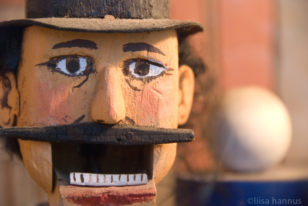 A wooden marionette of a man at the Musee Mechanique on the Embarcadero, San Francisco, California, waits with mouth open until someone puts a coin in the machine to activate the show.