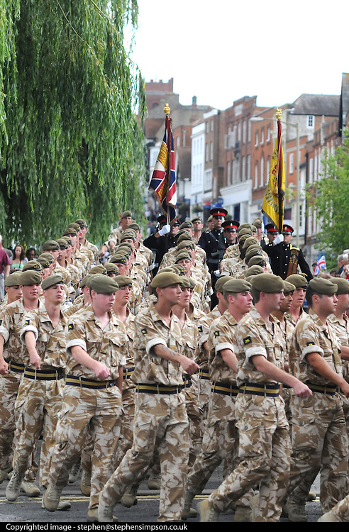 """.Residents and visitors to Guildford will have the chance to welcome home troops from the 1st Battalion Princess of Wales's Royal Regiment next week when they march through the town centre following their return from Iraq and Afghanistan...The Homecoming Parade, organised by Guildford Borough Council, will take place on Wednesday 15 July.  Around 200 soldiers from the local Regiment, also known as 'The Tigers', will set off from Millmead and parade through Guildford with the Kohima Band of the 3rd Battalion.  The Mayor of Guildford will host a reception at Holy Trinity Church for the troops, veterans and cadets...    Says Mayor of Guildford, Cllr Pauline Searle: """"Guildford warmly welcomes the 1st Battalion Princess of Wales's Royal Regiment home.  The Regiment has been historically associated with Guildford for many years and the troops are now in a position to exercise the Freedom of the Borough transferred to them in 1992.  We hope as many people as possible will come along to watch the parade and celebrate this special occasion""""...    Queen's Royal Surrey Regiment veteran Kenneth Honeyman, 93, adds: """"As a younger man I always attended the 5th Queen's Members' Association Open Days and marched through Guildford.  The parade will give me the opportunity to meet up with the few surviving old members and pay tribute to the soldiers who serve our country today""""...The salute will be taken by Guildford born and bred Colonel Patrick Crowley, the Vice-Lord Lieutenant Gordon Lee-Steere DL, and the mayor.  Two soldiers will be presented with medals by the mayor during the parade.  Private Bill Maguire, 18, from Guildford, who has served with the Battalion for two years will be awarded an operational tour medal for service in Iraq.  Following six years' service with the Battalion, Lance Corporal Kyle Denham, 22, from Portsmouth, will be awarded an operational tour medal for service in Afghanistan...The parade will assemble in the parking area at Millmead (which will be close"""