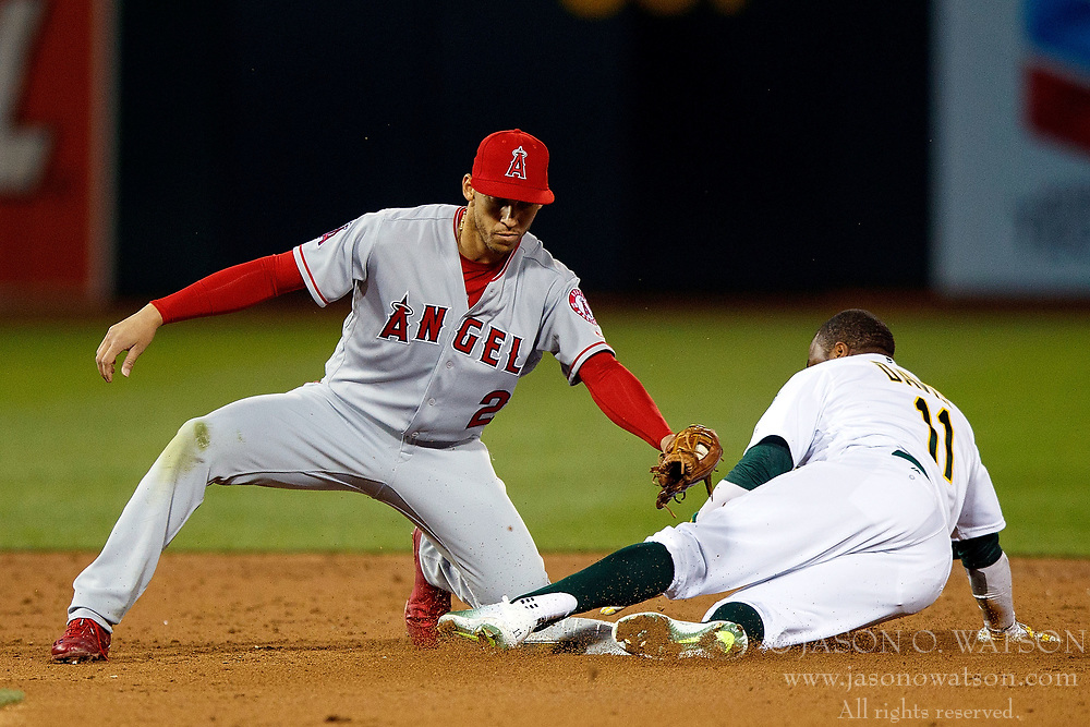 OAKLAND, CA - APRIL 04:  Rajai Davis #11 of the Oakland Athletics is tagged out attempting to steal second base by Andrelton Simmons #2 of the Los Angeles Angels of Anaheim during the third inning at the Oakland Coliseum on April 4, 2017 in Oakland, California. The Los Angeles Angels of Anaheim defeated the Oakland Athletics 7-6. (Photo by Jason O. Watson/Getty Images) *** Local Caption *** Rajai Davis; Andrelton Simmons
