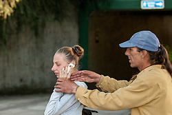 Male attacker mugs a young white female victim for her mobile phone, posed