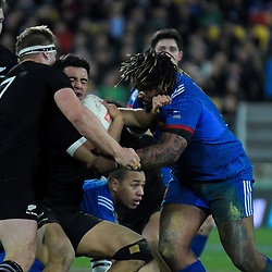 NZ's Anton Lienert-Brown holds off France's Mathieu Bastareaud during the Steinlager Series international rugby match between the New Zealand All Blacks and France at Westpac Stadium in Wellington, New Zealand on Saturday, 16 June 2018. Photo: Dave Lintott / lintottphoto.co.nz