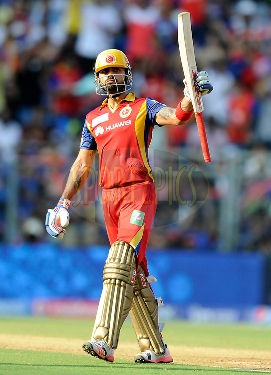 Virat Kohli captain of Royal Challengers Bangalore raises his bat after scoring a half century during match 46 of the Pepsi IPL 2015 (Indian Premier League) between The Mumbai Indians and The Royal Challengers Bangalore held at the Wankhede Stadium in Mumbai, India on the 10th May 2015.<br /> <br /> Photo by:  Pal Pillai / SPORTZPICS / IPL