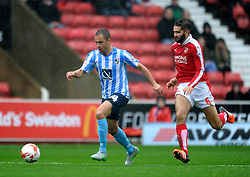 Joe Cole of Coventry City pursued by Jordan Turnbull of Swindon Town - Mandatory by-line: Paul Knight/JMP - Mobile: 07966 386802 - 24/10/2015 -  FOOTBALL - The County Ground - Swindon, England -  Swindon Town v Coventry City - Sky Bet League One