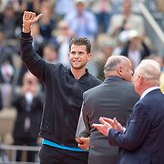 PARIS, FRANCE June 09.  Dominic Thiem of Austria salutes the spectators during presentations after his loss  against Rafael Nadal of Spain on Court Philippe-Chatrier during the Men's Singles Final at the 2019 French Open Tennis Tournament at Roland Garros on June 9th 2019 in Paris, France. (Photo by Tim Clayton/Corbis via Getty Images)