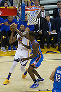 Golden State Warriors forward Kevin Durant (35) takes the ball to the basket against the Oklahoma City Thunder at Oracle Arena in Oakland, Calif., on November 3, 2016. (Stan Olszewski/Special to S.F. Examiner)
