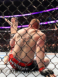 October 23, 2010; Anaheim, CA; USA; Brock Lesnar  and Cain Velasquez during their UFC Heavyweight Championship bout at UFC 121 at the Honda Center in Anaheim, CA.   Velasquez won via 1st round TKO.