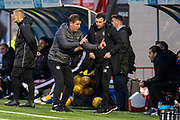 Heart of Midlothian manager Daniel Stendel discusses tactics with Heart of Midlothian coach Andy Kirk during the Ladbrokes Scottish Premiership match between Hamilton Academical FC and Heart of Midlothian at The Fountain of Youth Stadium, Hamilton, Scotland on 21 December 2019.